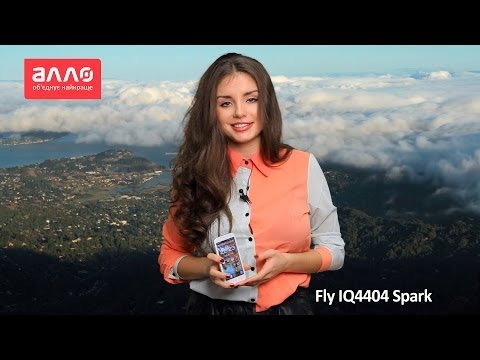 мобильный телефон fly iq4404 spark white видео обзор?>